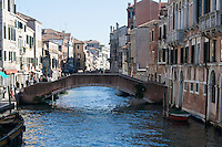 particular of a channel with buildings and bridge in Venice Italy