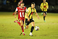 Jack Muldoon of Harrogate races clear of Pierce Sweeney of Exeter  during the EFL Sky Bet League 2 match between Harrogate Town and Exeter City at the EnviroVent Stadium, Harrogate, United Kingdom on 19 January 2021.