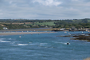 Views from the coastal path out to sea with boats moored at Parrog on 17th August 2021 in Newport, Pembrokeshire, Wales, United Kingdom. Newport is a town, parish, community, electoral ward and ancient port of Parrog, on the Pembrokeshire coast in West Wales at the mouth of the River Nevern in the Pembrokeshire Coast National Park.