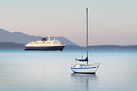 Alaska Ferry and sailboat  in Bellingham Bay on a calm morning, Bellingham,  Washington