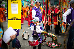 © Licensed to London News Pictures . 17/06/2018. Manchester , UK . Parade participants arrive and prepare for the 2018 Manchester Day parade , celebrating Manchester's cultural and social life and diversity, passes through Manchester City Centre . Photo credit : Joel Goodman/LNP