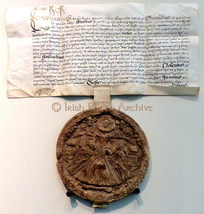The Official Image of Elizabeth 1. Queen Elizabeth commissioned a new Great Seal in 1584.  This drawing by Nicholas Hilliard (possibly 1547- died London 1619) may be one of the designs for the new seal. Impression 1594.  Dark brown wax on parchment. The seal was used to authorise important documents.