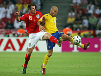 Photo: Chris Ratcliffe.<br /> Sweden v England. FIFA World Cup 2006. 20/06/2006.<br /> Freddie Ljungberg of Sweden clashes with xJamie Carragher of England.