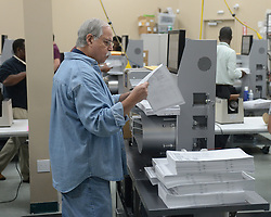 LAUDERHILL FL - NOVEMBER 13: Election Workers count early vote ballots at The Broward County Supervisor Of Elections Office during the Florida Recount on November 13, 2018 in Lauderhill, Florida. 13 Nov 2018 Pictured: Election Workers. Photo credit: MPI04/Capital Pictures / MEGA TheMegaAgency.com +1 888 505 6342