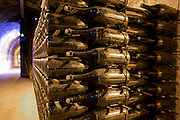 Methuselah bottles stacked and ageing in caves of Champagne Taittinger  in Reims, Champagne-Ardenne, France