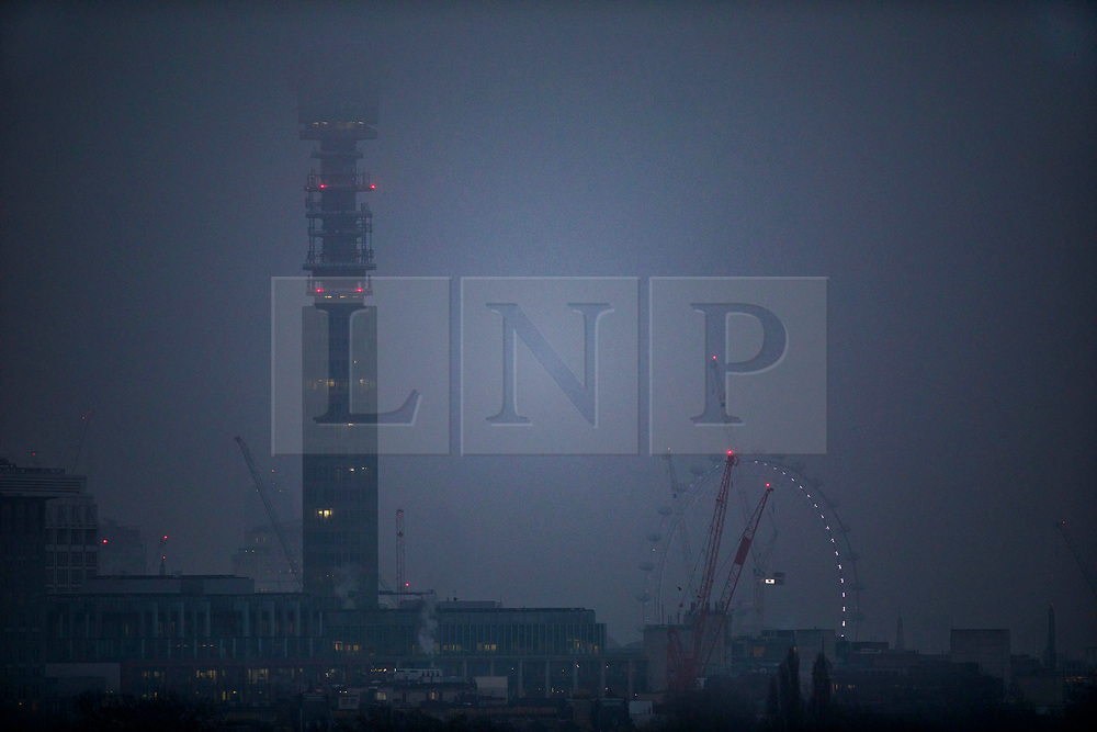 © Licensed to London News Pictures. 22/01/2020. London, UK. Seen from Primerose Hill, BT Tower and the London Eye are swathed in cloud, as the sub zero temperatures come to an end. Photo credit: Peter Macdiarmid/LNP