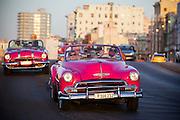Tourists at Malecon, Havana- Cuba