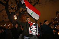 © Licensed to London News Pictures. 01/12/2015. London, UK. 'Stop the War' supporters protest against plans to extend the UK air strikes against ISIS from Iraq into Syria, in Parliament Square, London on Tuesday, 1 December 2015, the day before the House of Commons vote. Photo credit: Tolga Akmen/LNP