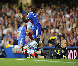 "Aston Villa's Brad Guzan watches Chelsea's Eden Hazard's effort go in  - Photo mandatory by-line: Joe Meredith/JMP - Tel: Mobile: 07966 386802 21/08/2013 - SPORT - FOOTBALL - Stamford Bridge - London - Chelsea V Aston Villa - Barclays Premier League - EDITORIAL USE ONLY. No use with unauthorised audio, video, data, fixture lists, club/league logos or ""live"" services. Online in-match use limited to 45 images, no video emulation. No use in betting, games or single club/league/player publications"