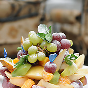 Fruit salad (grape, apple, pear, orange, mix) on a plate in fine restaurant
