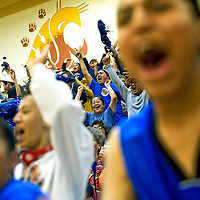 022813  Adron Gardner/Independent<br /> <br /> Fans celebrate as the Navajo Pine Warriors beat the Tohatchi Cougars by one point, 65-64, in Tohatchi Thursday.