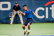 India's Somdev Dewarman returns a shot against USA's John Isner during their men's singles match at the Citi Open ATP tennis tournament in Washington, DC, USA, 1 Aug 2013. Isner won the match 7-5, 7-5 to advance.
