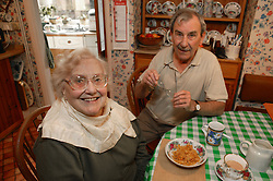 Couple at home having breakfast receiving homecare for the elderly,