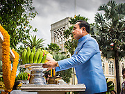 09 SEPTEMBER 2014 - BANGKOK, THAILAND:  Thai Prime Minister GENERAL PRAYUTH CHAN-OCHA prays at a Buddhist shrine on the grounds of Government House in Bangkok. Thai Prime Minister General Prayuth Chan-ocha named a cabinet that was dominated by members of the security forces to govern Thailand through at least a year of political reforms before elections are held. Prayuth and the cabinet met for the first time Tuesday. Before the meeting Prayuth said a prayer at a Buddhist shrine on the grounds of Government House, which is the Prime Minister's office. Prayuth seized power in a military coup in May. He was unanimously selected as Prime Minister by the National Legislative Assembly (NLA), the acting parliamentary body. Prayuth and his aides personally selected the members of the NLA after they seized power.      PHOTO BY JACK KURTZ