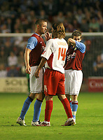 Photo: Mark Stephenson.<br /> Walsall v Aston Villa. Pre Season Friendly. 07/08/2007.Walasll's Carlos Carneiro slaps Villa's Gary Cahill on the face as tempers fray