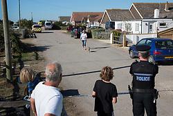 © Licensed to London News Pictures. 30/08/2016. Bognor Regis, UK. Local residents watch as an armed siege in Pagham comes to an end. A 72 year old man who has been in a stand-off with police since 4pm on Sunday has given himself up.  Photo credit: Peter Macdiarmid/LNP