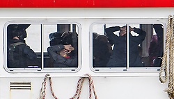 © Licensed to London News Pictures. 19/03/2017. London, UK. People playing hostages are seen holding their hands on their heads as anti-terrorist Police intercept a tourist boat, taken hostage by people playing armed terrorists, in an ant-terror training exercise takes place on The River Thames in  London. It is the first time that an exercise of this type has taken place on the river. Photo credit: Ben Cawthra/LNP
