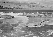 9305-B7385-02. View of Celilo Falls before dam closure. October 5, 1956. On the left is the tip of Big island. On the right is Papoose island and behind it is Chief island, further back is the main channel and the Albert Brothers islands.