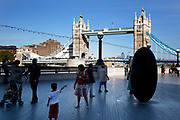 Scenes of both tourists near to Tower Bridge. This area is an icon for tourism, bringing thousands in each day.