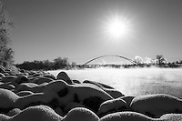 The Skipping Stone Bridge from Calgary's East Village to St. Patricks Island on a cold sunny day in winter. The Ice Fog drifting across the river glowing in the sun.<br /> <br /> ©2014, Sean Phillips<br /> http://www.RiverwoodPhotography.com