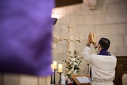 1 March 2020, Bethlehem: Rev. Munther Isaac breaks bread in preparation for Holy Communion during Sunday service in the Evangelical Lutheran Christmas Church in Bethlehem.