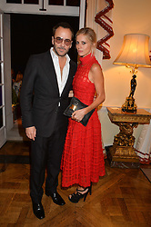 TOM FORD and LAURA BAILEY at a party hosed by the US Ambassador to the UK Matthew Barzun, his wife Brooke Barzun and editor of UK Vogue Alexandra Shulman in association with J Crew to celebrate London Fashion Week held at Winfield House, Regent's Park, London on 16th September 2014.