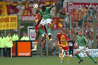 Fotball<br /> Frankrike 2004/05<br /> Lens v Saint Etienne<br /> 14. august 2004<br /> Foto: Digitalsport<br /> NORWAY ONLY<br />  FREDERIC PIQUIONNE (ST-E) / ALOU DIARRA (LENS)