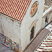 A view from above of a street, buildings and art for sale in the old city of Dubrovnik, Croatia. <br />