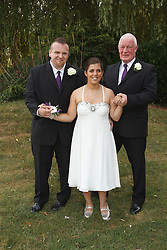 Bride who has cerebral palsy, with groom and her grandfather at wedding ceremony.