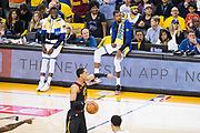 Golden State Warriors forward Kevin Durant (35) and Golden State Warriors forward Draymond Green (23) watch game play against the Cleveland Cavaliers during Game 1 of the NBA Finals at Oracle Arena in Oakland, Calif., on May 31, 2018. (Stan Olszewski/Special to S.F. Examiner)