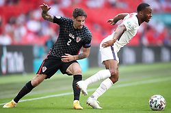 Croatia's Sime Vrsaljko (left) and England's Raheem Sterling in action during the UEFA Euro 2020 Group D match at Wembley Stadium, London. Picture date: Sunday June 13, 2021.