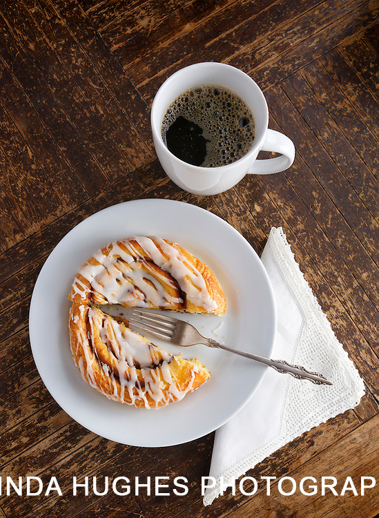 Overhead view of Pastry and Coffee on a rustic wooden surface