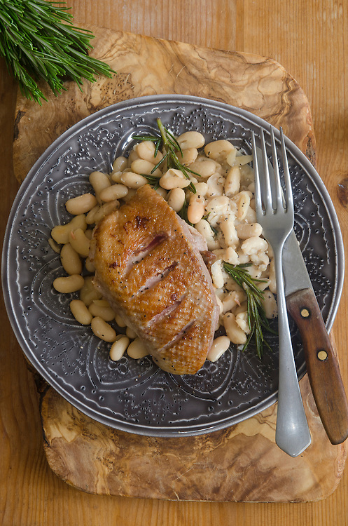 Roast duck with cannellini beans and rosemary