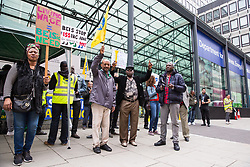 London, UK. 19 June, 2019. Outsourced catering, security, postal, porter and cleaning staff belonging to the Public & Commercial Services Union (PCS) and working at the Department for Business, Energy and Industrial Strategy (BEIS) via contractors ISS World and Aramark stand on the picket line outside the Government department on the third day of continuing industrial action for the London Living Wage, terms and conditions comparable to the civil servants they work alongside and an end to outsourcing.