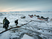 After a day hunting, Bent and Dina Ignatiussen return home. Life in and around the small Inuit settlement of Isortoq (population of 64), in East Greenland.