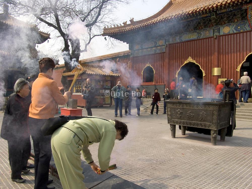 Chinese people praying at the Lama Temple Beijing China
