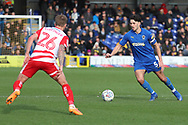 AFC Wimbledon defender Will Nightingale (5) taking on  Doncaster Rovers midfielder James Coppinger (26) during the EFL Sky Bet League 1 match between AFC Wimbledon and Doncaster Rovers at the Cherry Red Records Stadium, Kingston, England on 9 March 2019.