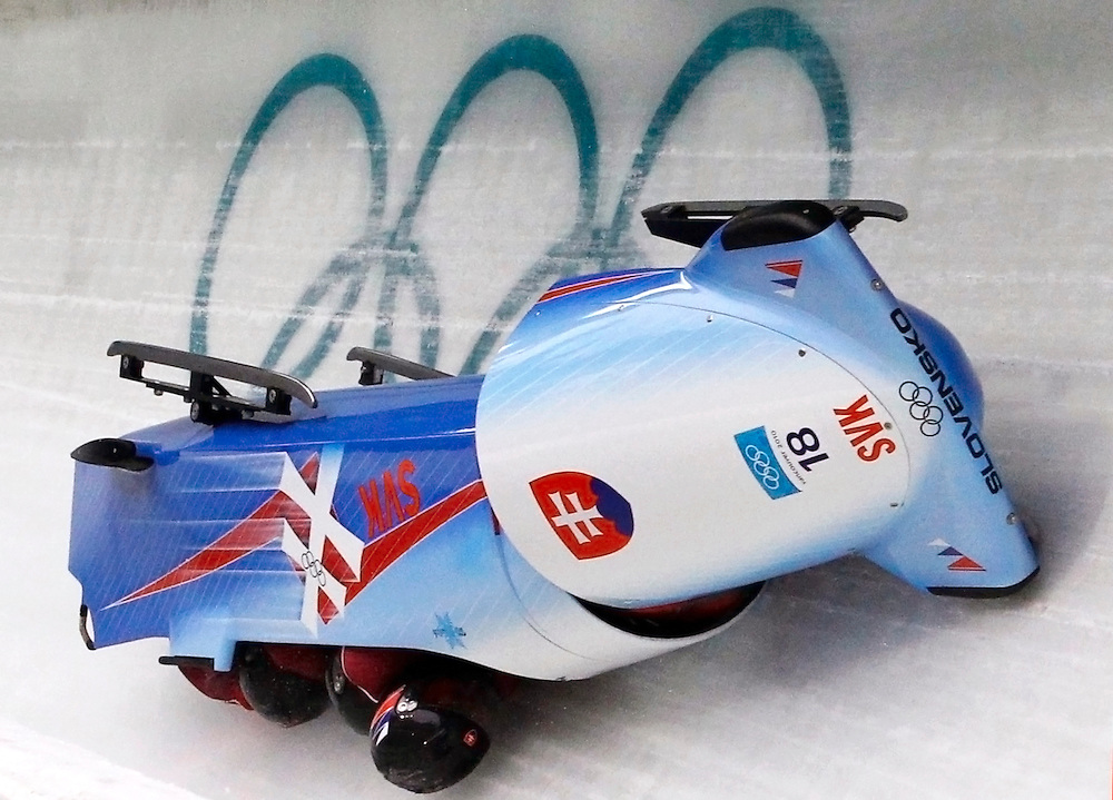 Pilot Milan Jagnesak, Martin Tesovic, Petr Narovec and Marcel Lopuchovsky of team Slovakia 1 crash during heat 1 of the four-man bobsleigh competition at the Vancouver 2010 Winter Olympics in Whistler, British Columbia, February 26, 2010.     REUTERS/Jim Young