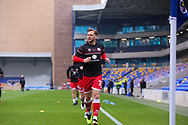 Crawley Town midfielder Dannie Bulman (21) warming up prior to kick off during the The FA Cup match between AFC Wimbledon and Crawley Town at Plough Lane, London, United Kingdom on 29 November 2020.