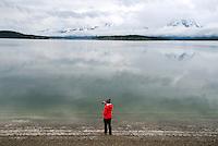 Savannah Sawyer, of Casper, takes a photo of Jackson Lake from Jackson Lake Dam last week in Grand Teton National Park.