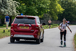 © Licensed to London News Pictures. 08/05/2020. London, UK. Police patrol Richmond Park as members of the public go out to exercise in South West London were temperatures are predicted to reach 25c for the Bank Holiday VE Day celebrations as mixed messages come out of Government on easing of lockdown. On Sunday the Prime Minister Boris Johnson will address the Nation on his plans on moving forward the current lockdown situation. Photo credit: Alex Lentati/LNP