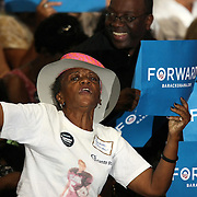 A supporter of President Barack Obama dances during his Grassroots event at the Kissimmee Civic Center in Kissimmee, Florida on Saturday, September 8, 2012. (AP Photo/Alex Menendez)