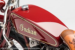 """""""Kiwidinok"""", (The Lady of the Wind) a red board track racer built with an Indian flathead by Kiwi Indian. Photographed by Michael Lichter during the Easyriders Bike Show in Columbus, OH on February 21, 2016. ©2016 Michael Lichter."""