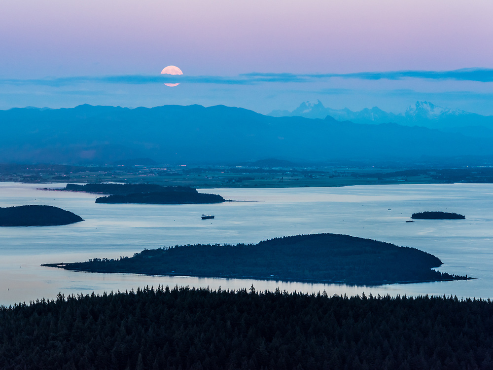 Moonrise over the Cascade mountains from the summit of Mt Constitution, Moran State Park, Orcas Island