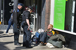A police officer talks to a homeless man in Windsor, Berkshire ahead of the wedding of Prince Harry and Meghan Markle this weekend.