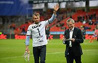 Fotball Tippeligaen Rosenborg - Aalesund<br /> 6 april 2015<br /> Lerkendal Stadion, Trondheim<br /> <br /> Petter Northug ble hedret for sin innsats i Falun i pausen. Til høyre : Bjørn Skjæran<br /> <br /> <br /> Foto : Arve Johnsen, Digitalsport