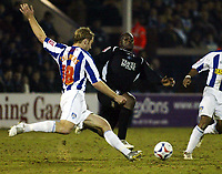 Photo: Chris Ratcliffe.<br /> Colchester United v Swansea City. LDV Vans Trophy. 14/03/2006.<br /> Adebayo Akinfenwa (R) of Swansea closes down Liam Chilvers of Colchester
