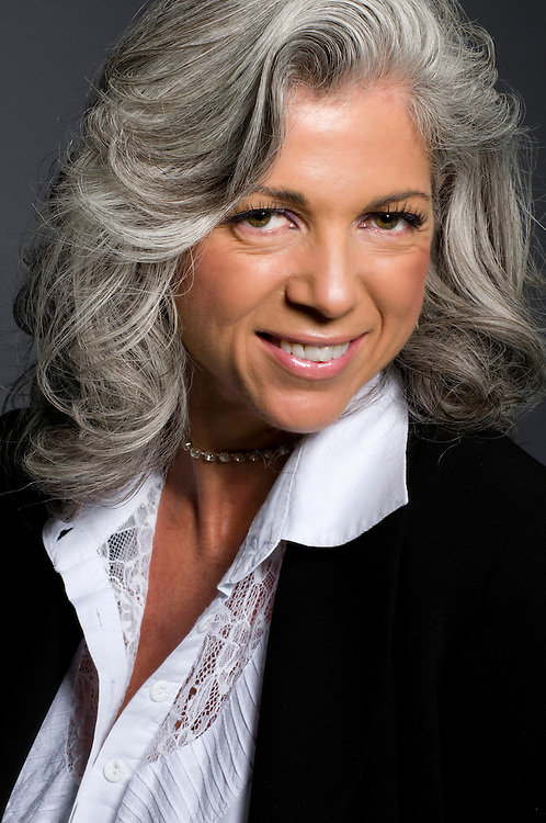 Portrait of business woman in her fifties smiling.