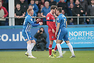 Nathan Thomas (Hartlepool United) and Jamie Devitt (Carlisle United) go head to head after Jamie Devitt (Carlisle United) takes exception to the Hartlepool United player going down under a challenge during the EFL Sky Bet League 2 match between Hartlepool United and Carlisle United at Victoria Park, Hartlepool, England on 14 April 2017. Photo by Mark P Doherty.