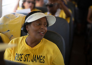 """Sharon Lavigne on a bus in St. James Louisaina on the third day of a five day march through Louisiana's 'Cancer Alley' held by the Coalition Against Death Alley. The Coalition Against Death Alley (CADA), is a group of Louisiana-based residents and members of various local and state organizations, is calling for a stop to the construction of new petrochemical plants and the passing of stricter regulations on existing industry in the area that include the groups RISE St. James, Justice and Beyond, the Louisiana Bucket Brigade, 350 New Orleans, and the Concerned Citizens of St. John . Louisiana's Cancer Alley, an 80-mile stretch along the Mississippi River, is also known as the """"Petrochemical Corridor,"""" where there are over 100 petrochemical plants and refineries ."""
